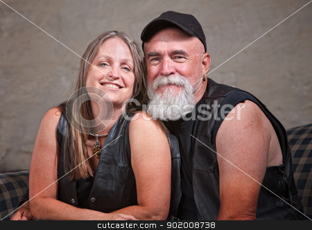 Mature Smiling Couple stock photo, Adorable mature biker couple wearing leather vests by Scott Griessel