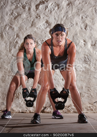 Beautiful Women in Boot Camp Style Workout stock photo, Pretty Caucasian woman lift kettle bell weights with both hands by Scott Griessel