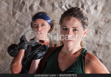 Two Serious Women Working Out stock photo, Two serious sweating women holding weights indoors by Scott Griessel