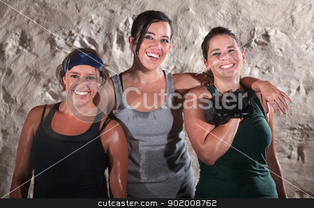 Three Sweaty Boot Camp Workout Women stock photo, Three smiling young European female athletes standing together by Scott Griessel