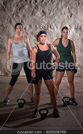 Standing Women Doing Boot Camp Style Workout stock photo, Pretty women pausing during a sweaty workout by Scott Griessel