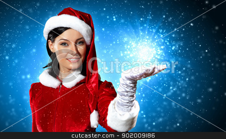 Portrait of girl wearing santa claus clothes stock photo, Portrait of beautiful girl wearing santa claus clothes on red background by Sergey Nivens
