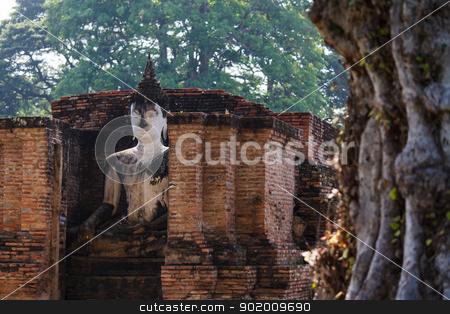 An ancient Buddha image stock photo, An ancient Buddha image at Sukhothai historical park, Thailand by pattarastock