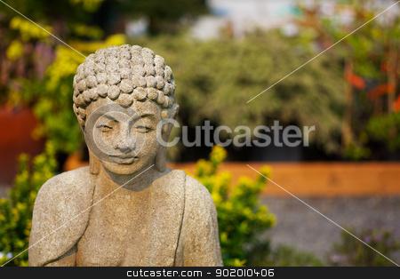 Shallow focus Buddha garden stock photo, Shallow focus image of concrete Buddha  in an asian garden by bobkeenan