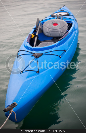 Blue Kayak stock photo, Blue kayak floating on calm water by Katie Smith
