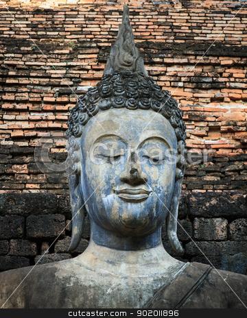 An ancient Buddha image stock photo, An ancient Buddha image at Sukhothai historical park, Thailand by Pugping
