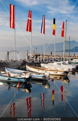 Porto di Cisano - Lago di Garda (Italy) stock photo, Cisano harbor with boats and flags to Garda Lake  - Verona - Italy by catalby