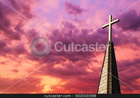 Steeple Cross at Sunset stock photo, Colorful sunset sky backs a gleaming golden cross high atop a church steeple by Kenneth Keifer