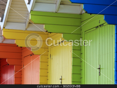 Colorful beach chalets stock photo, Row of colorful wooden beach chalets. by Martin Crowdy
