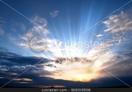 Sunset. stock photo, Dark clouds with sun rays over sea. by Sergey Nivens