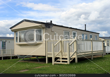 Holiday caravan or mobile home stock photo, Holiday caravan or mobile home on trailer park. by Martin Crowdy