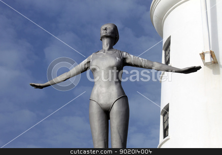 Lighthouse and diving belle statue stock photo, Lighthouse and diving belle statue, Scarborough, England. by Martin Crowdy