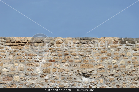 Old brick wall background stock photo, Horizontal old brick wall with blue sky background and copy space. by Martin Crowdy