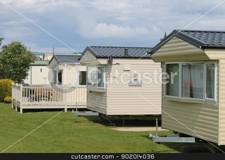 Static caravan trailer homes in park stock photo, caravans; trailers; park; homes; accommodation; white; cream; exterior; facade; buildings. typically english; static; spacious; modern, row, summer by Martin Crowdy