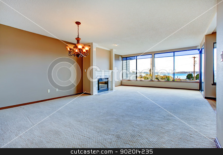 Apartment living room with large windows. stock photo, Apartment living room with large windows, carpet and hardwood floor. by iriana88w