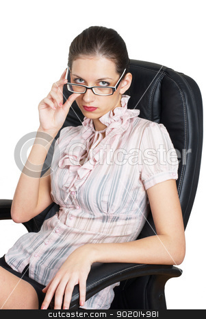 Young businesswoman stock photo, Young lady - chief sitting on chair in office by Aikon