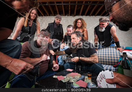 Aggressive Biker Gang Gamblers stock photo, Rowdy biker gang gambling and pulling out weapons by Scott Griessel