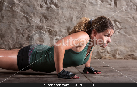 Lady Does Push-ups stock photo, One beautiful young woman doing push ups indoors by Scott Griessel