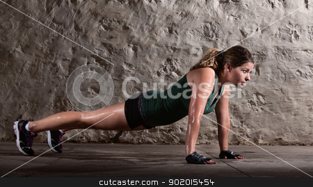 Woman Doing Push-ups Alone stock photo, Pretty young doing push ups and sweating by Scott Griessel
