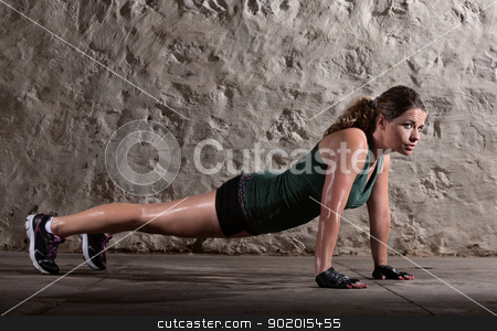 Lady Doing Push-ups stock photo, Pretty woman doing push ups and sweating indoors by Scott Griessel