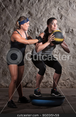 Boot Camp Workout Balance Training stock photo, Pretty boot camp fitness instructor with lady on bosu by Scott Griessel