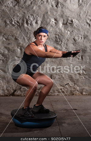 Pretty Lady Doing Balancing Training stock photo, Strong young white woman doing balancing training by Scott Griessel
