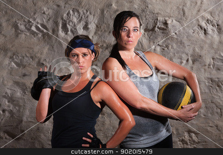 Boot Camp Traning Women Holding Equipment stock photo, Pair of beautiful women holding boot camp training equipment by Scott Griessel