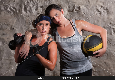 Confident Boot Camp Training Partners stock photo, Strong Caucasian woman with workout partner flexing her bicep by Scott Griessel