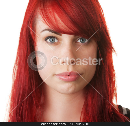 Pretty Woman Staring stock photo, Pretty young European female with red hair staring by Scott Griessel