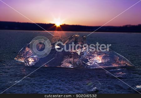 iceberg stock photo, a beautiful sunset iluminating through iceberg by photomim