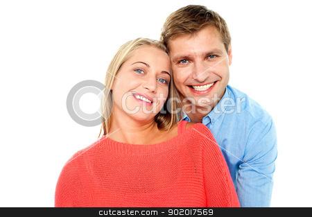 Beautiful young happy couple stock photo, Beautiful young happy couple on white background by Ishay Botbol
