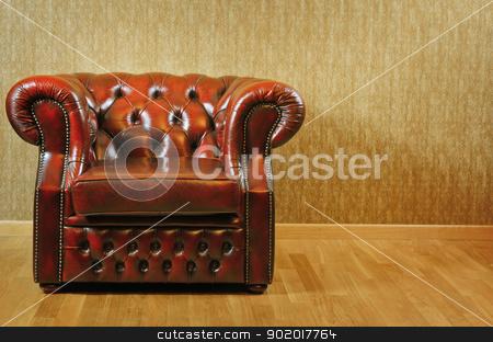 Armchair stock photo, Single Old Antique Armchair Near The Wall by Sergej Razvodovskij