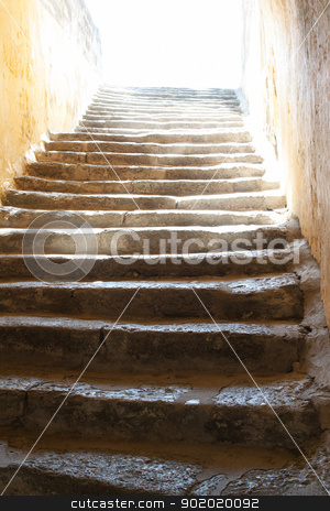Steps to the light stock photo, Old stone stairway leading up to the blinding light. These are the stairs leading to the entrance of the Castle of St Peter in Bodrum, Mugla Province, Turkey. by Brigida Soriano