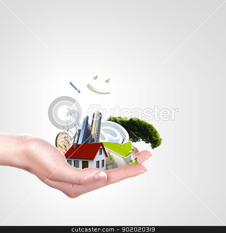 Human hand against blue sky background and house stock photo, Human hand against blue sky background and house by Sergey Nivens