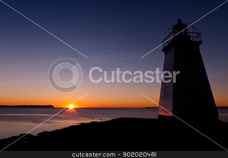 Lighthouse during sunrise in the early morning  stock photo, Lighthouse during sunrise in the early morning with beautiful colors by Ulrich Schade