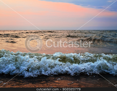 sunset at stormy sea stock photo, sunset at stormy sea with waves by Sergej Razvodovskij