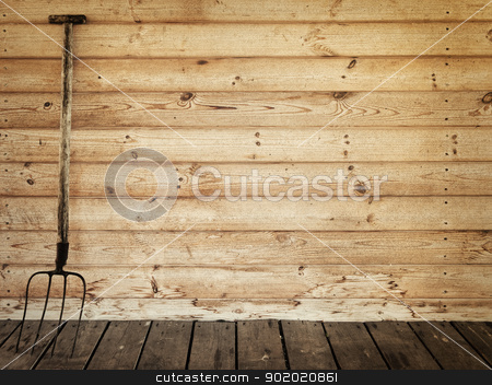 pitchfork stock photo, old pitchfork near the wooden wall by Sergej Razvodovskij