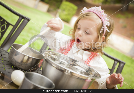 Adorable Little Girl Playing Chef Cooking stock photo, Happy Adorable Little Girl Playing Chef Cooking in Her Pink Outfit. by Andy Dean