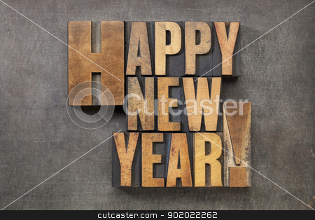 Happy New Year! stock photo, Happy New Year! - text in vintage letterpress wood type blocks on a grunge metal background by Marek Uliasz