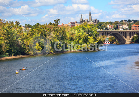 Key Bridge Georgetown University Washington DC Potomac River stock photo, Key Bridge Potomac River Kayaks Georgetown University Washington DC from Roosevelt Island.  Completed in 1923 this is the oldest bridge in Washington DC. by William Perry