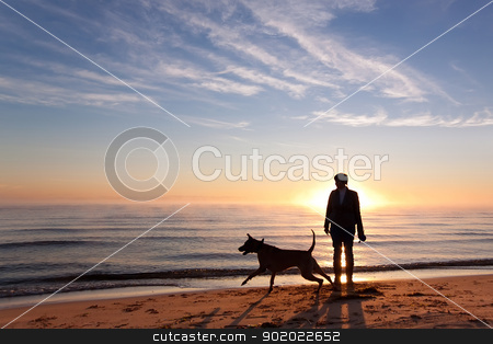 Sunrise stock photo, Woman plays with dog on the shore of the lake at sunrise by Yulia Chupina