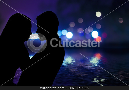 Couple Silhouettes stock photo, Couple between the city lights by carloscastilla