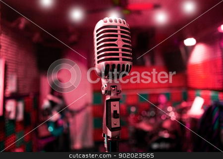 live music background stock photo, Abstract background music with vintage microphone and musicians by carloscastilla