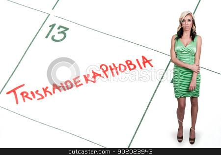 Triskaidekaphobia stock photo, Woman with a calendar entry on Friday the 13th for Triskaidekaphobia by Robert Byron
