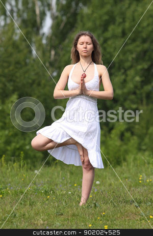 Yoga exercises stock photo, Young woman doing Yoga exercise outdoors by Yulia Chupina