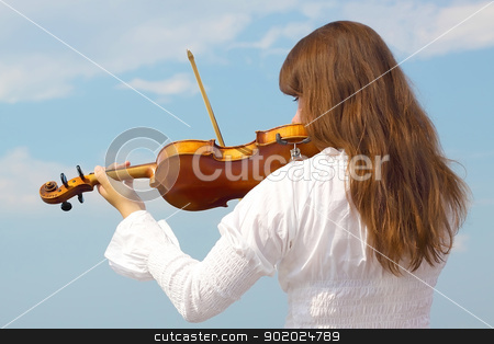 Girl with violin stock photo, Young woman playing violin on sky background  by Yulia Chupina