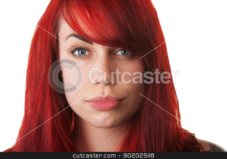 Pretty Woman Pouting stock photo, Beautiful red haired woman pouting over white background by Scott Griessel