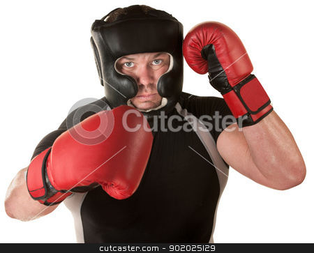 Defensive Boxing Move stock photo, One isolated male boxer with headgear blocking by Scott Griessel