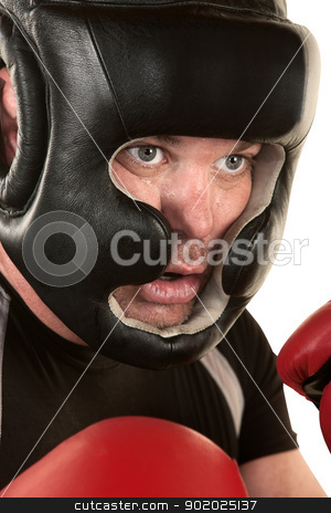 Male Boxer Close Up stock photo, Close up of male boxer in safety helmet on white background by Scott Griessel