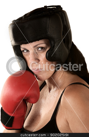 Serious Female Boxer Sweating stock photo, Sweating Hispanic female boxer with gloves and head protection by Scott Griessel